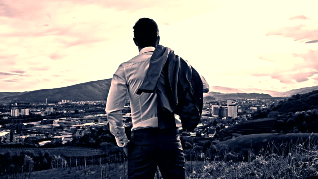 slo mo businessman looking across the city - standing stock videos & royalty-free footage