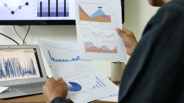 businessman looking and analyzing business project document - market research stock videos and b-roll footage
