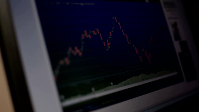 Businessman looking at graph stock Market