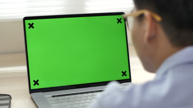 businessman looking at green screen computer - desktop pc stock videos & royalty-free footage