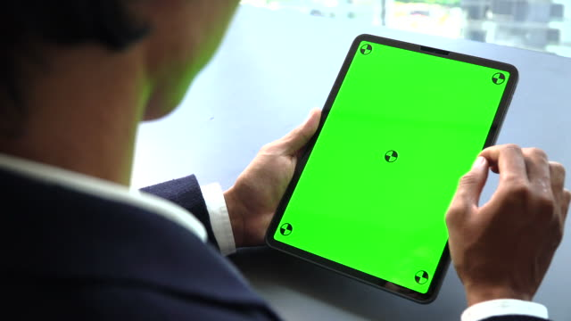 businessman looking at tablet green screen - holding stock videos & royalty-free footage