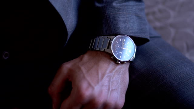 businessman looking at the time on his wrist watch - suit stock videos & royalty-free footage