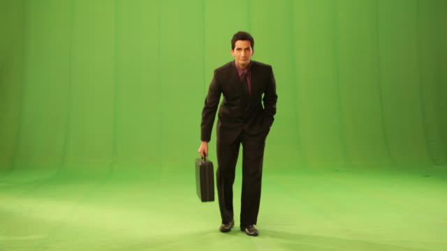 businessman looking confident  - green background stock videos & royalty-free footage