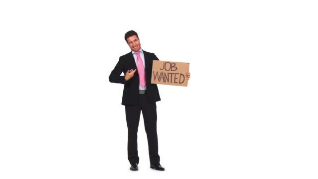 vídeos de stock e filmes b-roll de hd: empresário à procura de trabalho - camisa e gravata