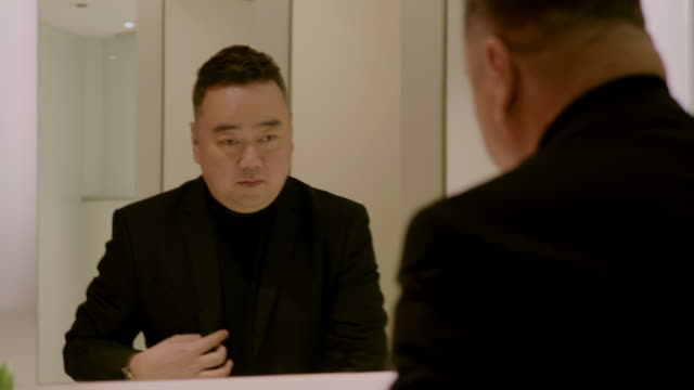 businessman looking in mirror - public restroom stock videos and b-roll footage