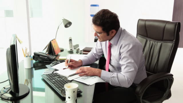 businessman looking serious in an office  - mistake stock videos & royalty-free footage