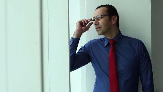 Businessman looking through a window