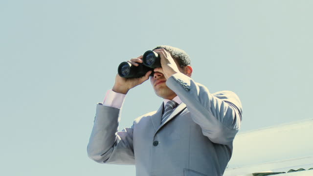 ms la businessman (16-17) looking through binoculars / cape town, south africa - one teenage boy only stock videos and b-roll footage