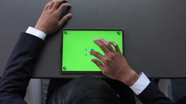 businessman looking using digital tablet green screen - showing stock videos & royalty-free footage