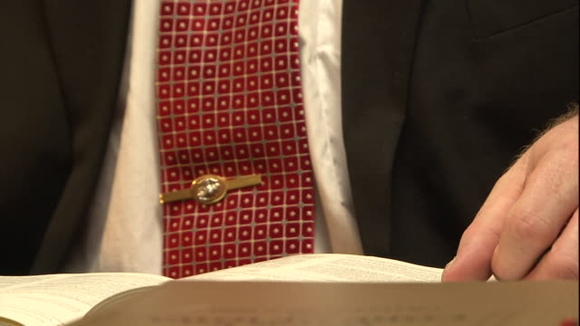 a businessman looks through a book and writes down notes. - report stock videos & royalty-free footage