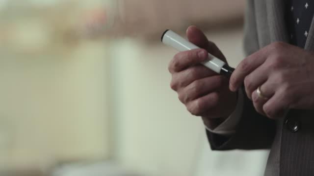 vídeos de stock e filmes b-roll de businessman moves expo marker in hand. - vestuário de trabalho formal
