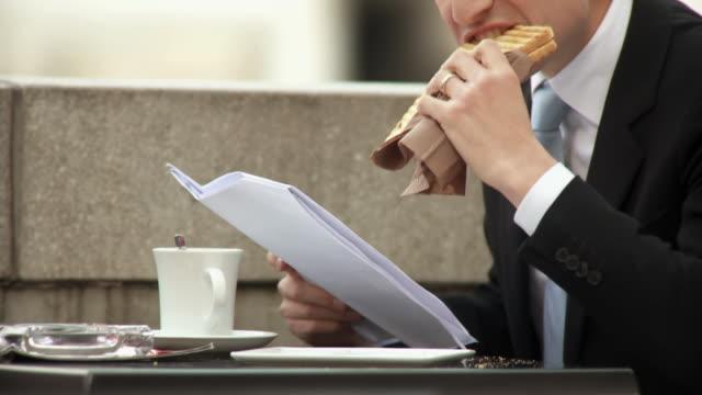 hd: businessman on a lunch break - lunch break stock videos & royalty-free footage