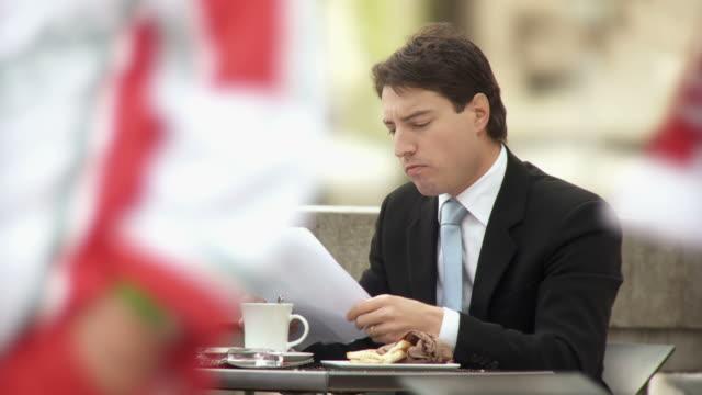 hd: businessman on a lunch break - sandwich stock videos & royalty-free footage