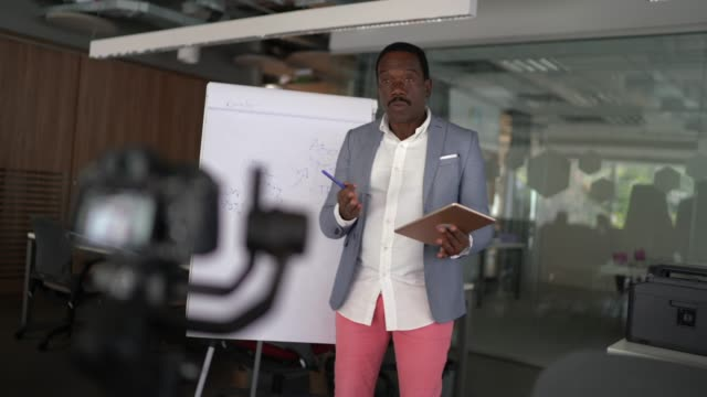 businessman on a presentation online, video meeting - camera recording - sales pitch stock videos & royalty-free footage