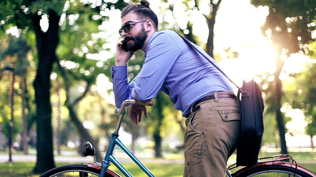 businessman on bicycle using his phone - one mid adult man only stock videos & royalty-free footage