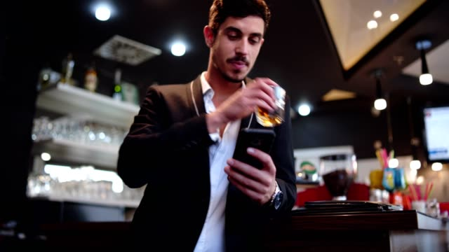 businessman on break in the bar - bar counter stock videos & royalty-free footage