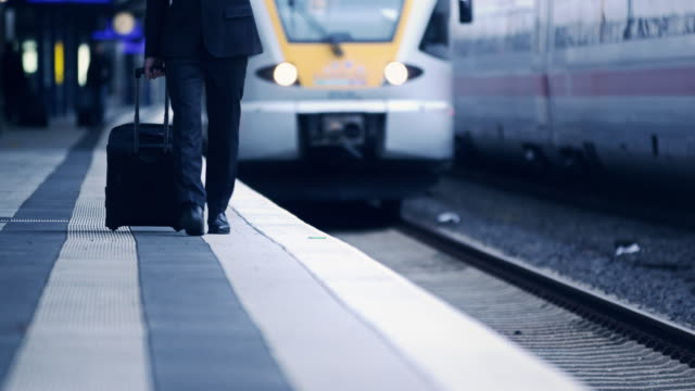 businessman on phone at station - waiting stock videos & royalty-free footage