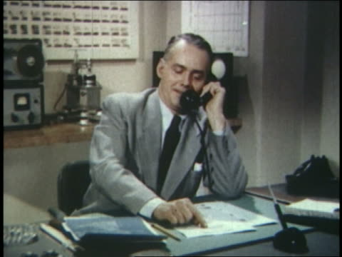 1954 businessman on phone in office - 1954 bildbanksvideor och videomaterial från bakom kulisserna