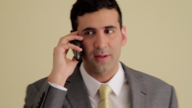 cu businessman on phone - raised eyebrows stock videos and b-roll footage