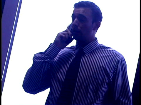 businessman on phone - hemd und krawatte stock-videos und b-roll-filmmaterial