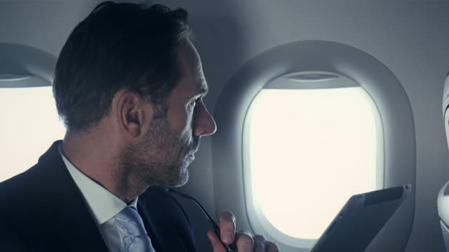 businessman on plane - looking stock videos & royalty-free footage
