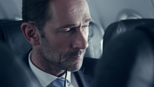 Businessman on plane