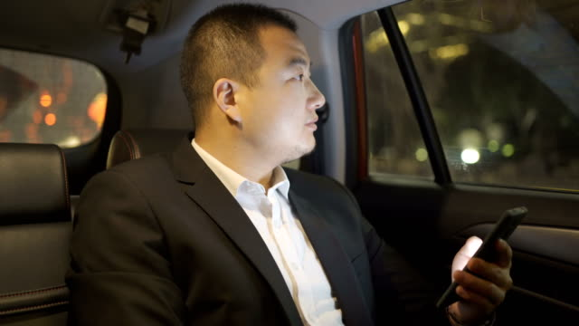 businessman on the back seat of a car - sedile del passeggero video stock e b–roll
