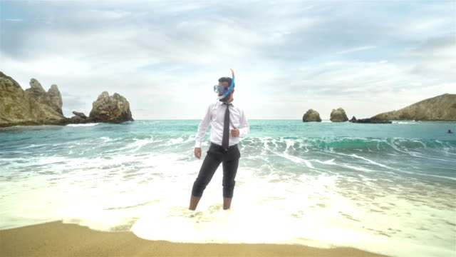 Businessman on the Beach - 4K Resolution