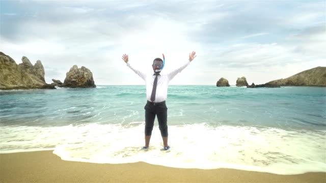 businessman on the beach - 4k resolution - bizarre fashion stock videos and b-roll footage