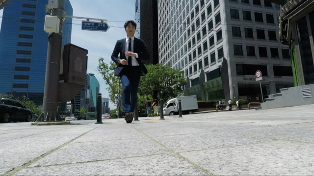 businessman on the go in seoul downtown - seoul stock videos & royalty-free footage