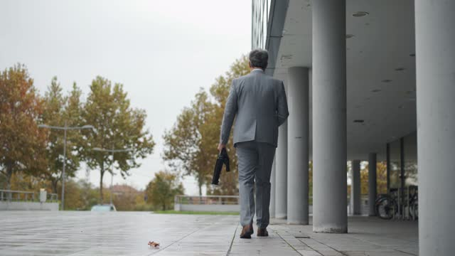 businessman on the move - grey hair stock videos & royalty-free footage