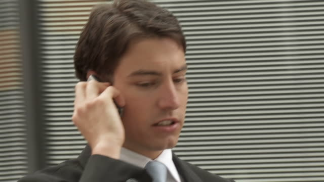 hd slow-motion: businessman on the phone - spinning point of view stock videos & royalty-free footage