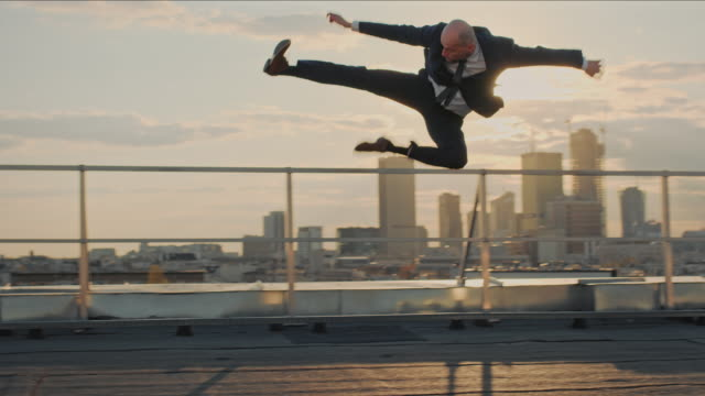 businessman on the rooftop. crazy jump - high up stock videos & royalty-free footage
