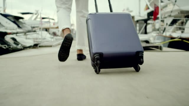 businessman on vacation. walking with suitcase on marina - yacht stock videos & royalty-free footage