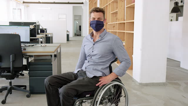 businessman on wheelchair in face mask at office - button down shirt stock videos & royalty-free footage