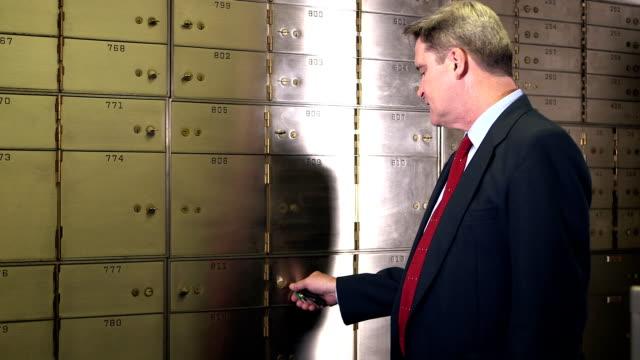 Businessman opening safety deposit box