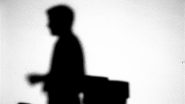 businessman pacing by desk - in silhouette stock videos & royalty-free footage