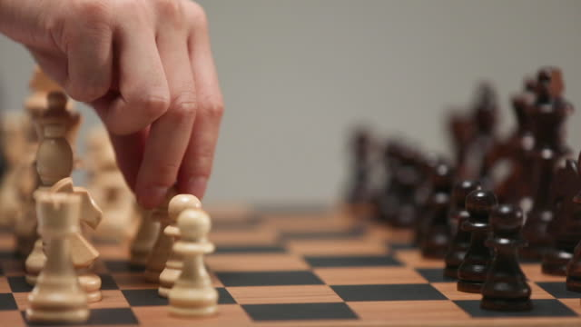 businessman playing chess and holding a piece - chess stock videos & royalty-free footage