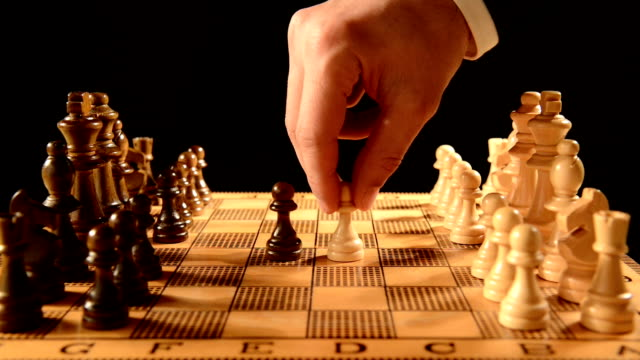 businessman playing chess - chess stock videos & royalty-free footage