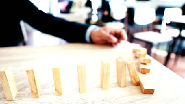 businessman playing dominoes. - toy block stock videos and b-roll footage