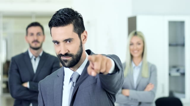 businessman pointing on you - pointing stock videos and b-roll footage