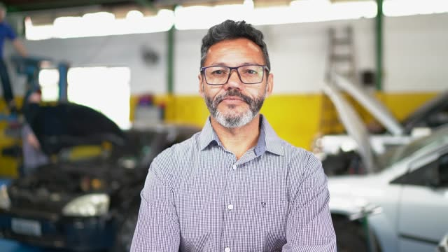 businessman portrait in auto repair shop - waist up stock videos & royalty-free footage