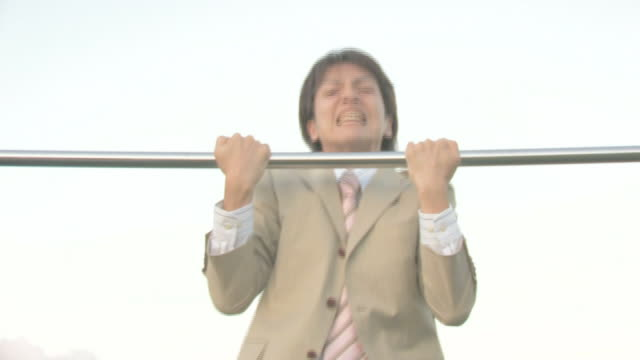 businessman practicing on horizontal bar - horizontal bar stock videos and b-roll footage