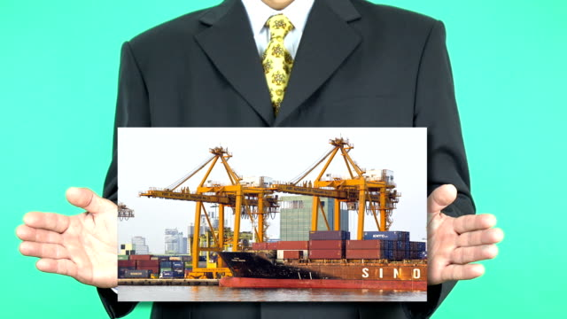 Businessman presenting Container Cargo freight ship
