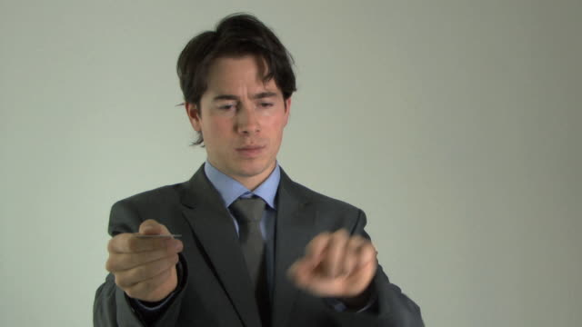 cu businessman pretending to use atm machine / hackney, united kingdom    - hackney stock-videos und b-roll-filmmaterial