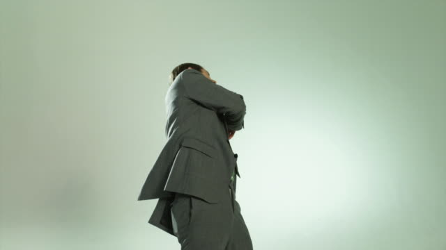 businessman punching himself in the face - sado maso stock-videos und b-roll-filmmaterial