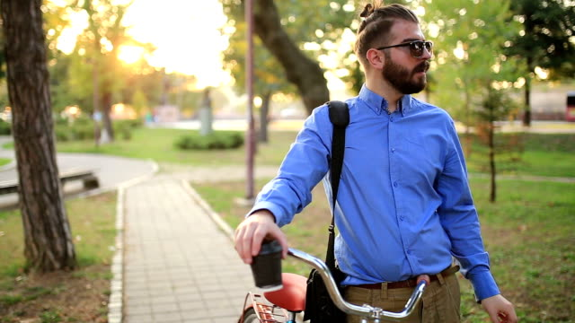 Businessman Pushing Bicycle and going home late