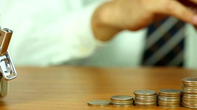 Businessman put coin stack money