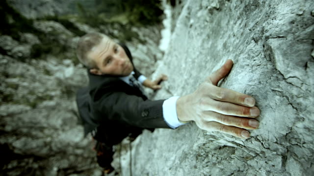 hd: businessman reaching for the next hold - free climbing stock videos & royalty-free footage