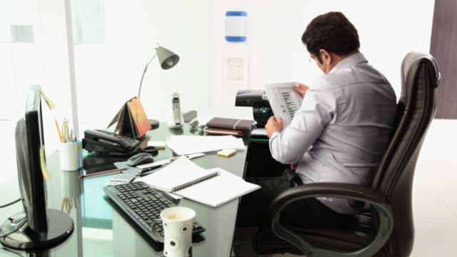Businessman reading a paper